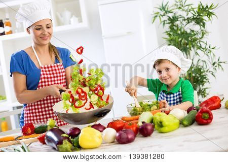 Beautiful Happy Smiling Family Cooking Vegetables Meal