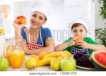 Happy family eating fresh healthy food in the kitchen