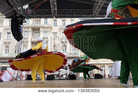 ZAGREB, CROATIA - JULY 20: Members of Al Tannoura Folklore Troupe, Cairo, Egypt during the 50th International Folklore Festival in center of Zagreb, Croatia on July 20, 2016