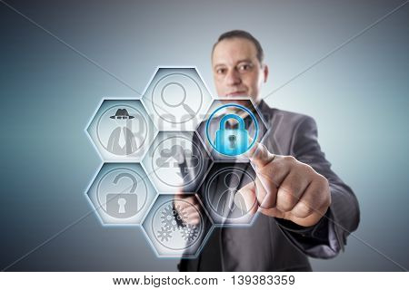 Business man in gray suit locking a virtual padlock for fraud prevention. Business concept for protection from data theft electronic deception civil and criminal offense perpetrated via internet.