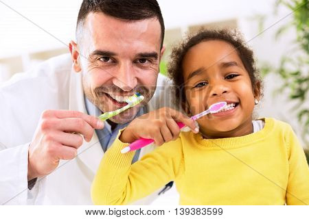 Pediatrician Learn Cute African Girl Brushing Tooth