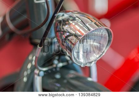 Bike Detail On Red Background. Modern Good Looking Bicycle With Gray Light..
