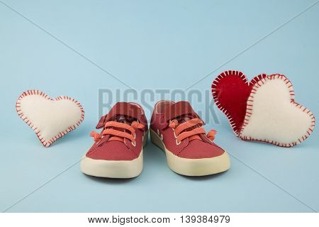portrait of little girl shoes with hearts