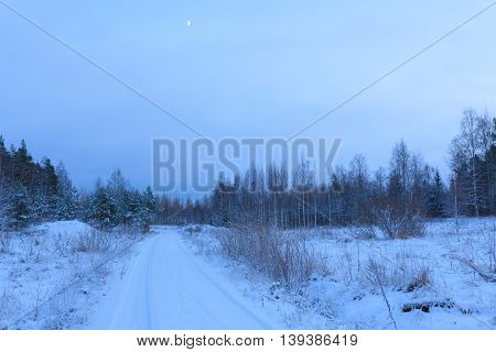Snow dirt road at countryside Finland winter