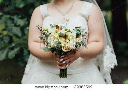 Beautiful Bouquet In Hands Of The Very Fat Bride
