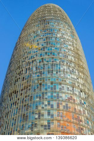BARCELONA SPAIN - JULY 10 2016: The Agbar Tower - is a skyscraper of 38 floors in Barcelona. The tower was designed by architect Jean Nouvel.