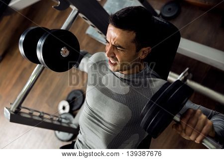 Strong Man Holding Huge Weight And Working Bench Press