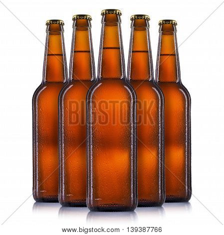 Set bottles of beer with drops isolated on white background.