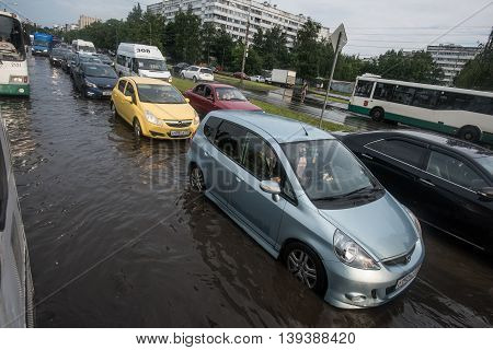 Saint-Petersburg Russia - June 16 2016: Public car trunk after a rain storm. Passenger cars are in the traffic jam.