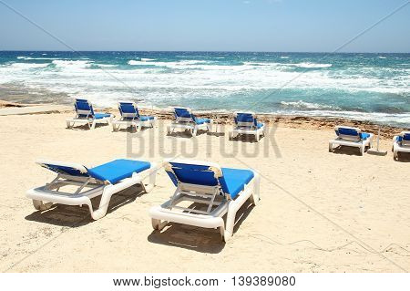 deck chairs on the beach on the sea
