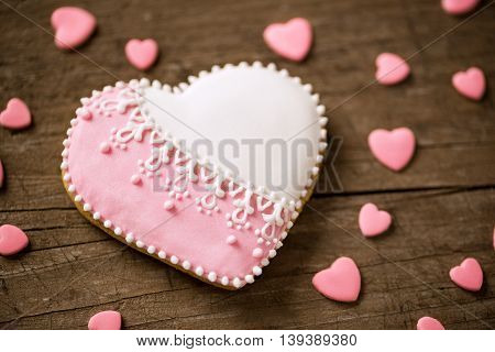 Sweet valentine cookie on wooden desk, holiday concept