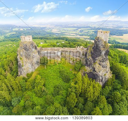 Ruins of gothic castle Trosky in National Park Cesky Raj (Czech Paradise). Aerial view to medieval monument in Czech Republic. Central Europe.