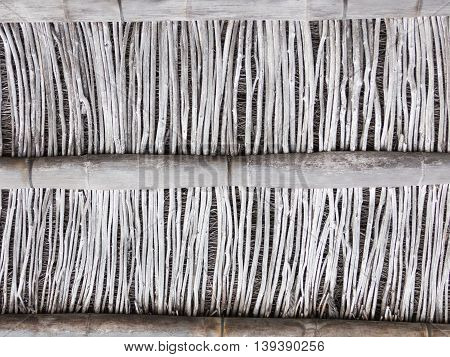 old gray wall partition of large and small dilapidated dry bamboo