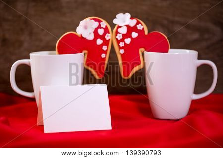Valentine day cups with festive cookies, couple love concept