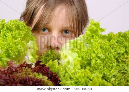 Beautiful young girl with the lettuce.