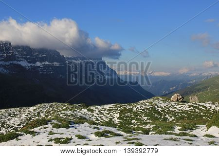 Scene after snowfall in Summer. View from a place near Klausenpass towards Glarus. Swiss Alps.