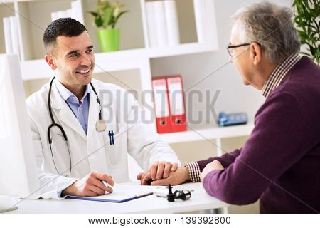 Young Doctor Holding Hand And Console His Patient