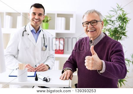 Satisfied Old Patient With Success Young Doctor