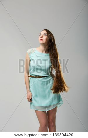 Portrait of beautiful girl with perfect long shiny healthy hair studio shot