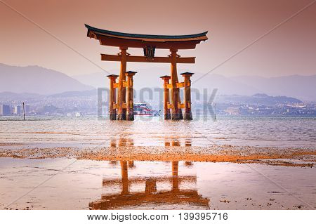 MIYAJIMA, JAPAN - famous floating torii gate of the Itsukushima Shrine on Miyajima at sunset