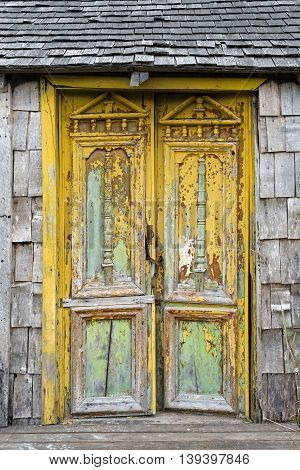 Old damaged door in Castro Chiloe Island Chile