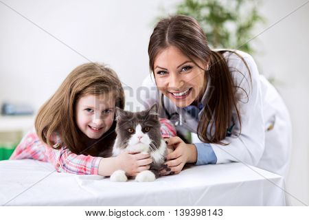 Kid With Pet At The Veterinary Doctor