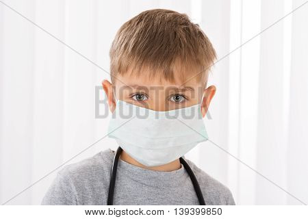 Portrait Of A Boy Doctor With Surgical Mask