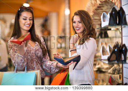 Happy Women Buying Shoes in a Store