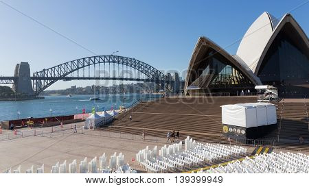 Sydney - February 25 2016: Stairs Sydney Opera House and the auditorium on the street the Harbour Bridge and people walk February 25 2016 Sydney Australia