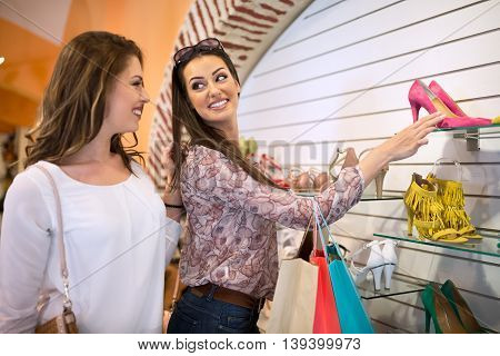 Smiling happy positive girl select summer shoes
