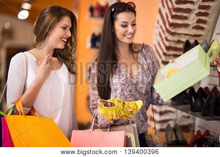 Women Buying summer Shoes in a Store