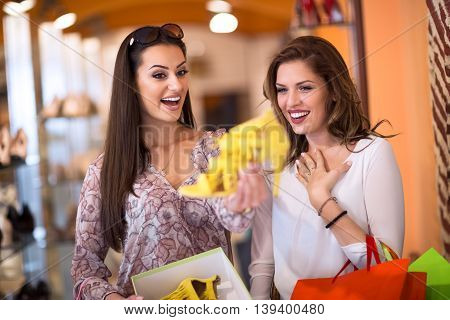 Young beautiful girl finding the perfect pair of shoes