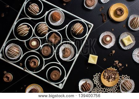 A variety of chocolate bon bons on a dark background