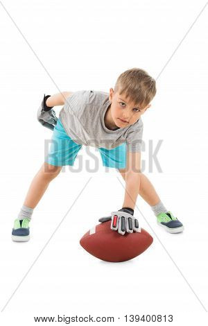 Portrait Of Boy Holding American Football Over White Background