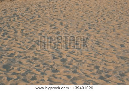 Background of yellow sand pattern created by the wind
