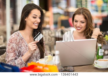 Online shopping with credit card and enjoy with friend at cafe