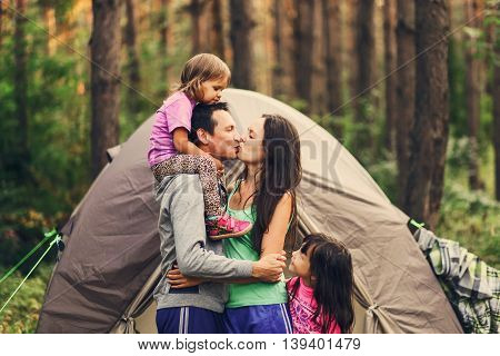 The Happy family together at a campsite.