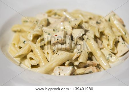 Traditional italian food - creamy penne with salmon
