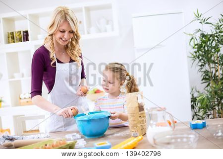 Mother Teaching Child How To Make Dough