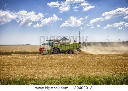 combine harvester working in a wheat field.