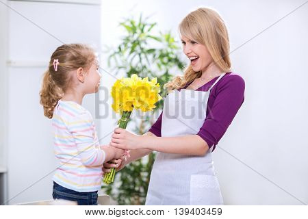 Daughter Donates Mother A Bouquet Of Flowers For Mother's Day