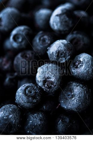 Close up photo of frozen blueberries, dark and blue