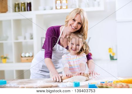 Smiling Happy Mother And Daughter In The Kitchen