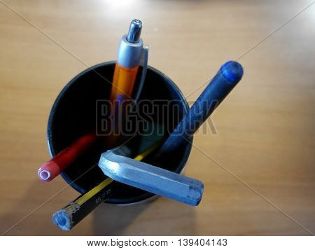 the boat of pens and a hex key