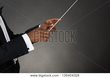 Close-up Of Music Conductor Hands Holding Baton