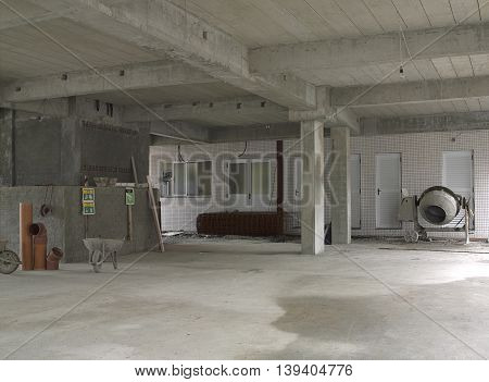 Interior photograph of a work being finished.