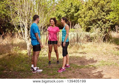 Three Joggers Talking On A Break