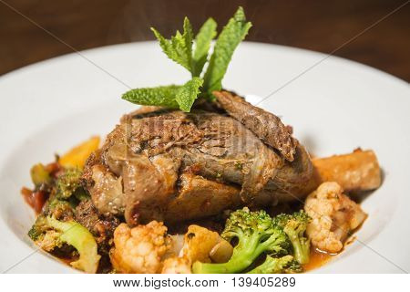 Roast leg of lamb with broccoli and cauluflower