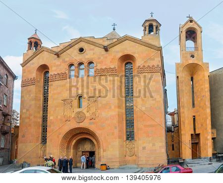 YEREVAN ARMENIA - MAY 29 2016: The orange travertine facade of St Sarkis Cathedral that is the seat of the Araratian Pontifical Diocese of the Armenian Apostolic Church on May 29 in Yerevan.