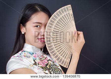 Beautiful Asian Woman With A Hand Fan